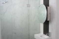 Ensuite with a hexagonal mosaic feature tile
